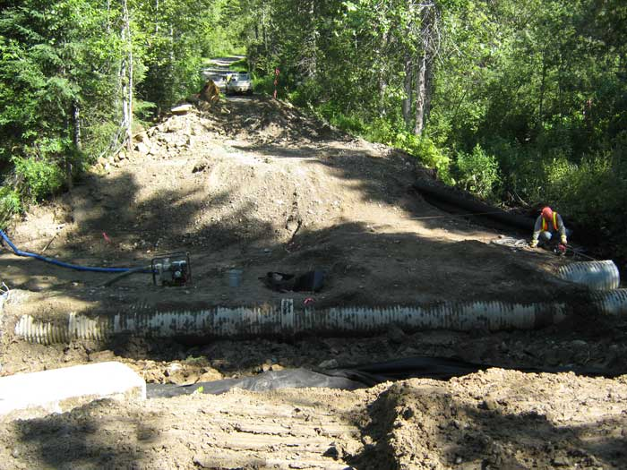 Nahanni Construction exposing Culverts before building bridge for BC hydro
